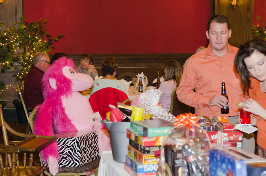 Sean & Jenn enjoyng a refreshment while inspecting some auction merchandise.jpg