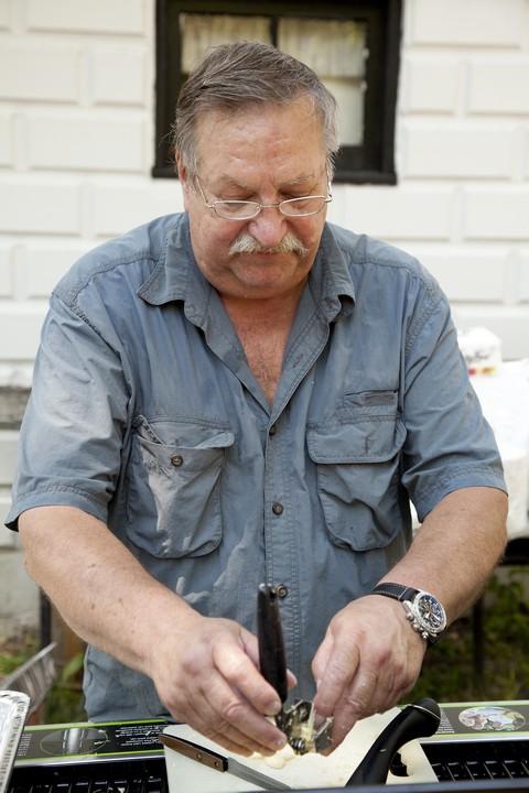 Ron crushing garlic.jpg